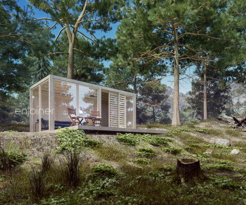 Kubikowy domek modułowy w lesie